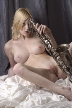 Short-haired babe loves her sax