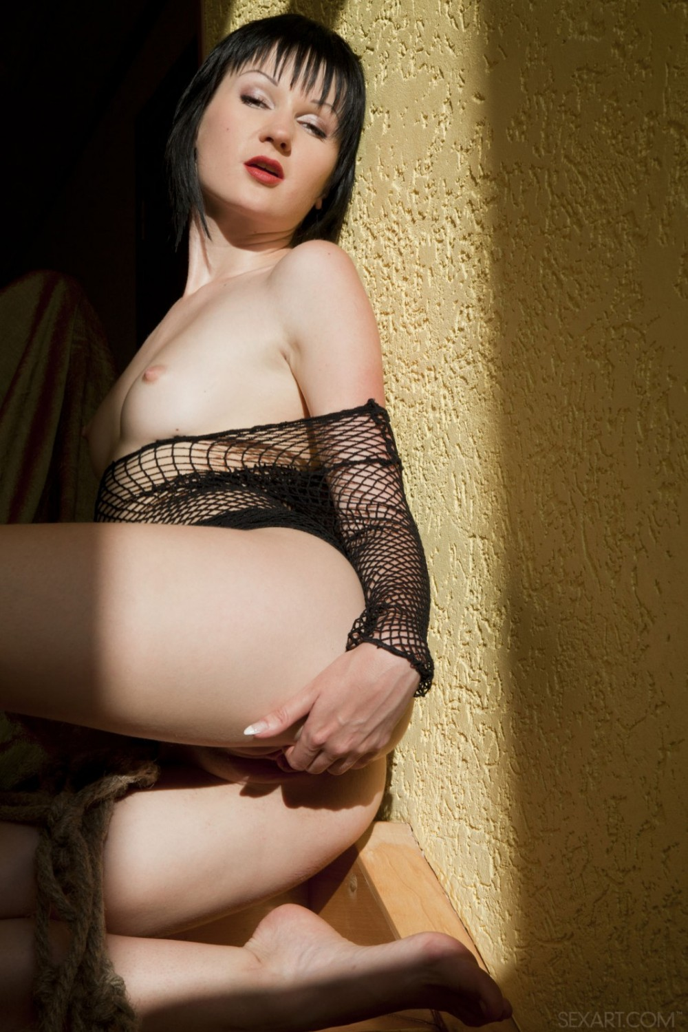 Beautiful black haired angel loves to wear fishnets