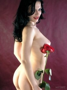 Stunning black haired darling loves flowers