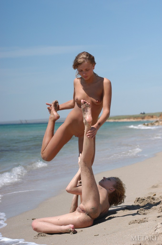 Fooling around naked at the sunny beach
