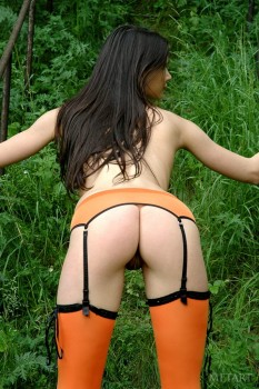 Hot beauty in orange stockings
