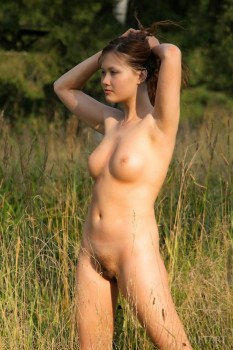 Watch a fine babe jump in the field.