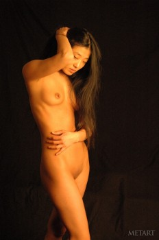 Sexy Asian in a passionate posing scene