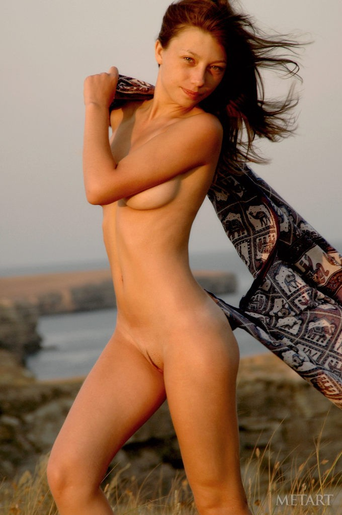 Gorgeous brunette in a solo posing scene