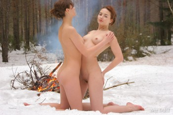 Beautiful teens posing around the campfire