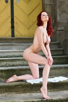 Ideal redhead posing naked outdoor