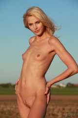 Slim blondie shows every inch of her shaved body.