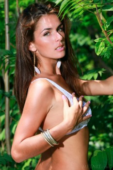 Hot brunette loses her clothes in the forest