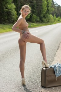 Naked hitchhiker plays with her pussy on the road