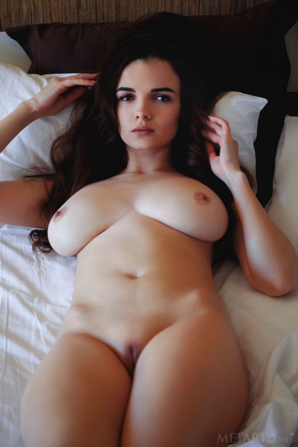 Hottie plays with her big boobs in her bed
