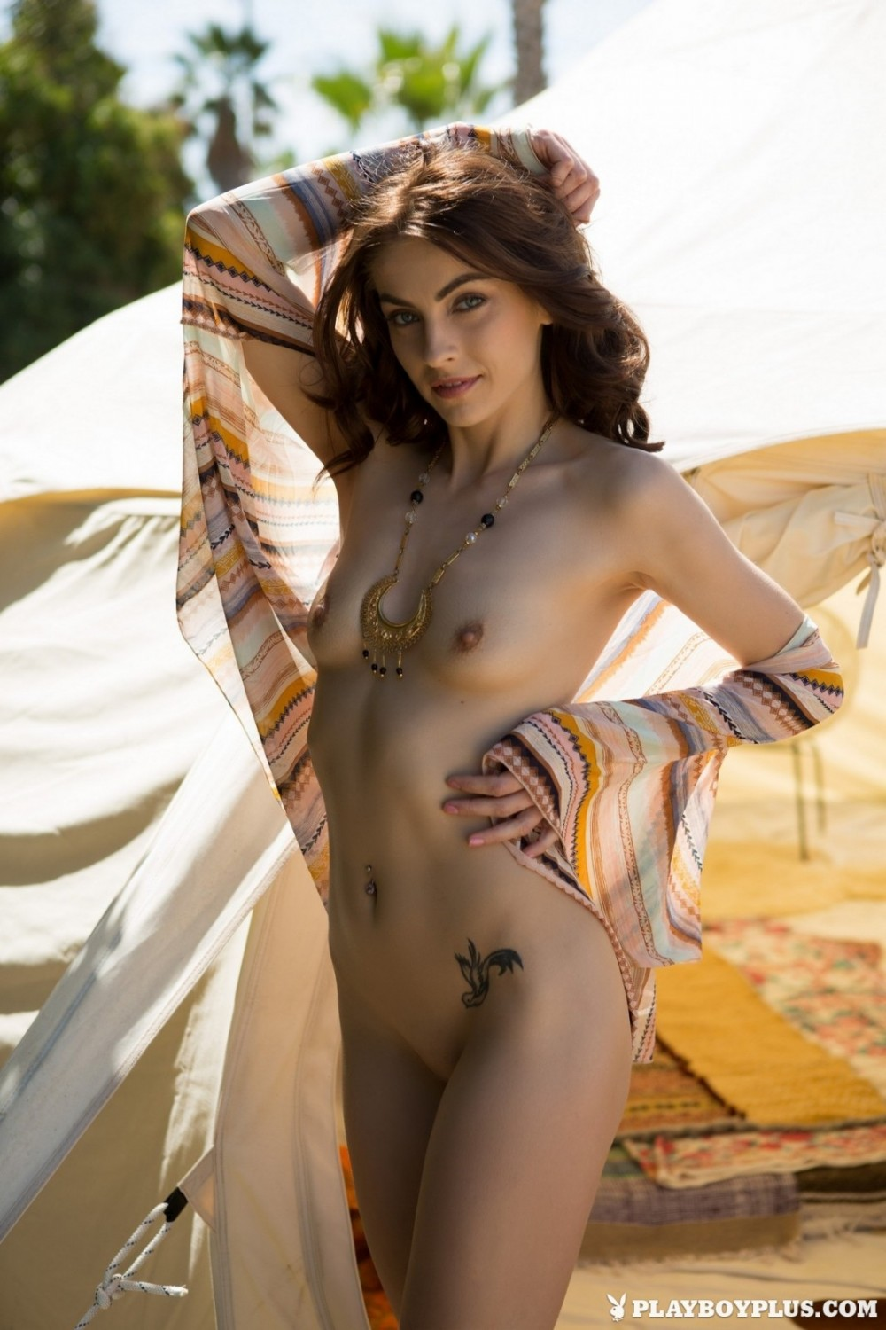 Naked chick gets satisfaction in the tent